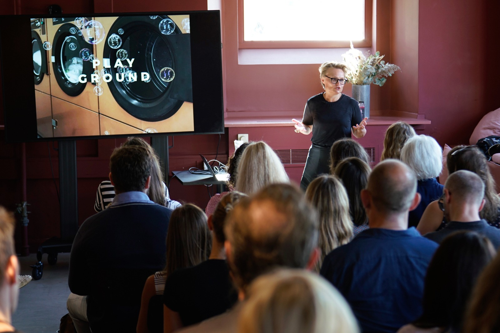 Event photography: Mette Willert - todays speaker - shot with Lomography Neptune