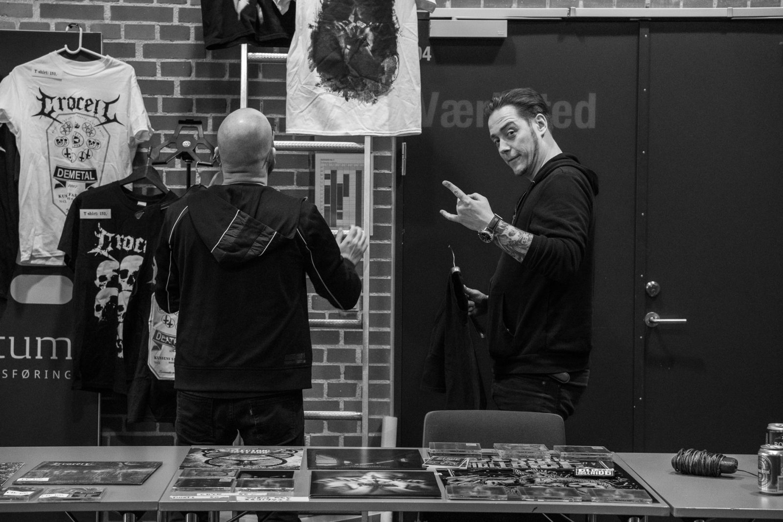Concert Photography: Casper Villumsen and Brian Olsson getting merchandise ready at Hammer Smashed Face in Frederikshavn, 2019