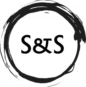 Images shows a black circle made with drawing ink and a brush, with the letters 'S & S' written inside. it is the logo of my shop, Stationary N' Stationery.