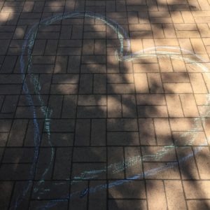 Heart themed co-created chalk drawing