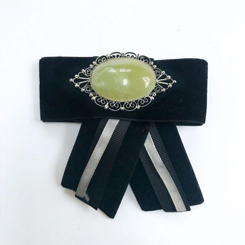 Vintage brooch green stone black velvet
