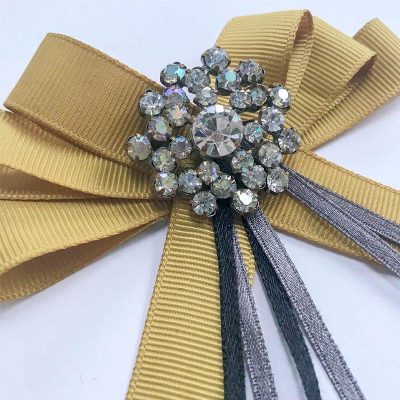 Vintage brosch diamanter gula band