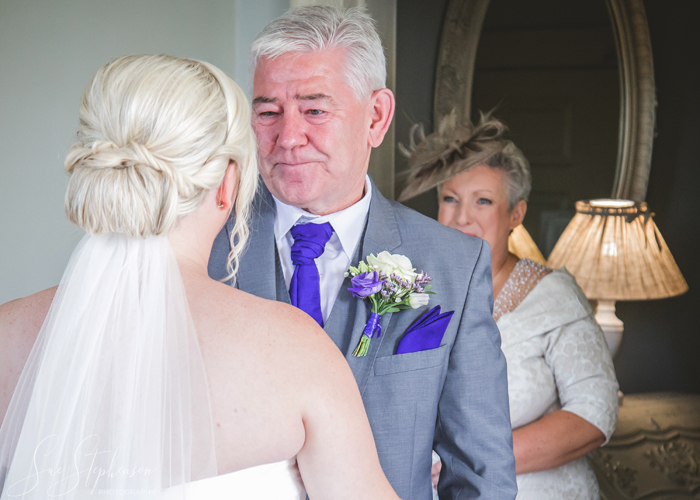 bride and emotional father