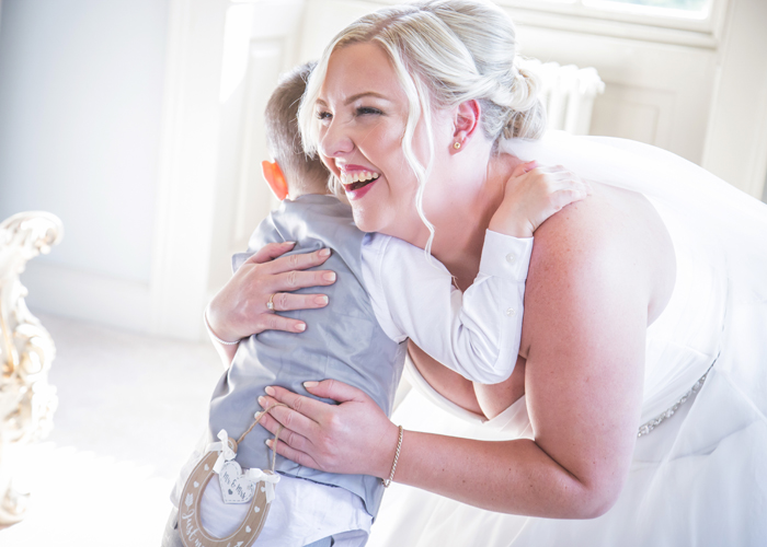 bride and page boy laughing