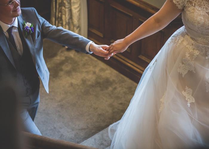 bride groom holding hands