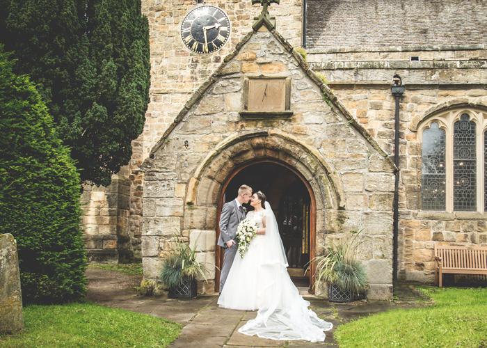 bride groom outside st marys church ponteland