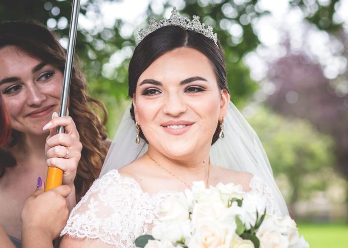 bride with bridesmaid umbrella