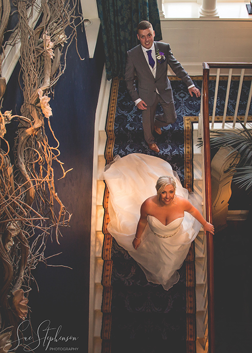newton hall bride and groom on stairs