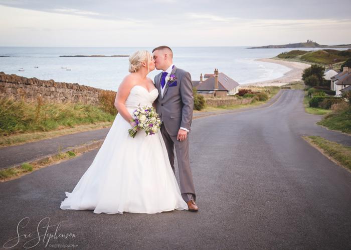 wedding photo dunstanburgh castle in background