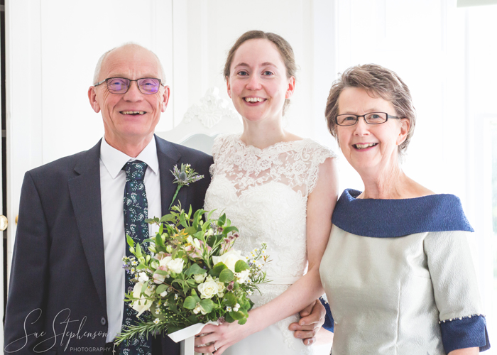 mother and father of the bride with bride