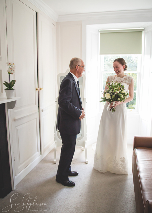 bride and father laughing before wedding