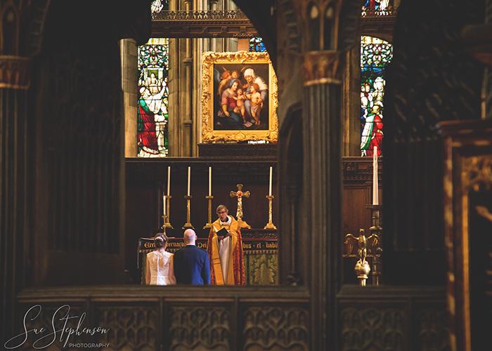hexham abbey bride groom kneeling at altar