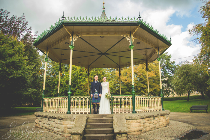 hexham bandstand bride and groom pose