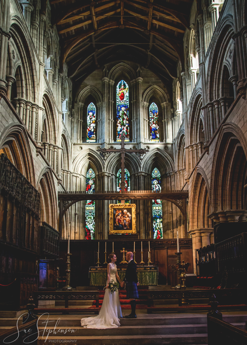 hexham abbey wedding bride and groom at altar
