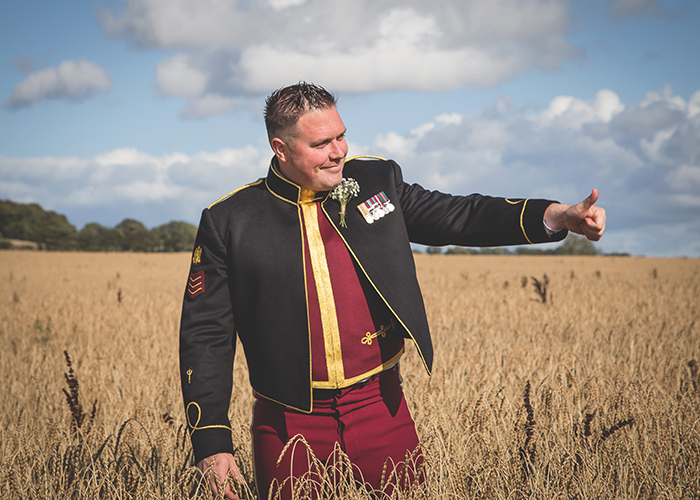 groom in wheat field