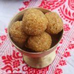 Gur diya narikolor laru (Coconut balls with jaggery)