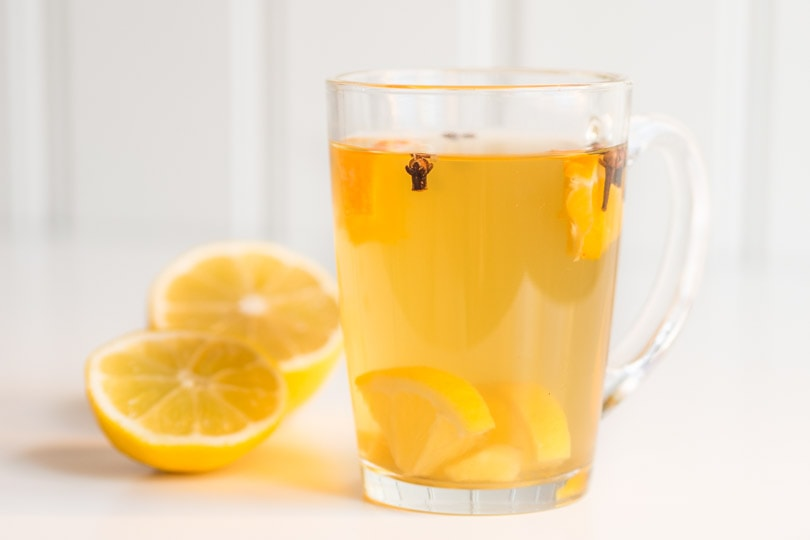 Green tea with lemon, orange, ginger and cloves