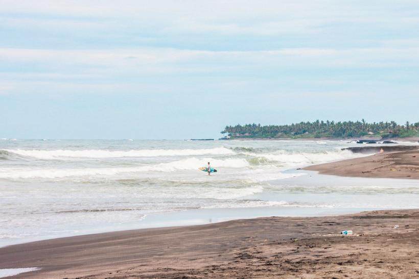 Surfer at Echo Beach Canggu