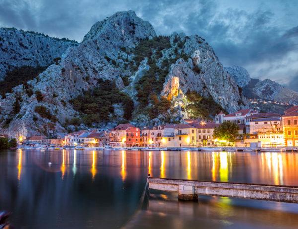 Lights reflecting in the ocean in Omis, Croatia