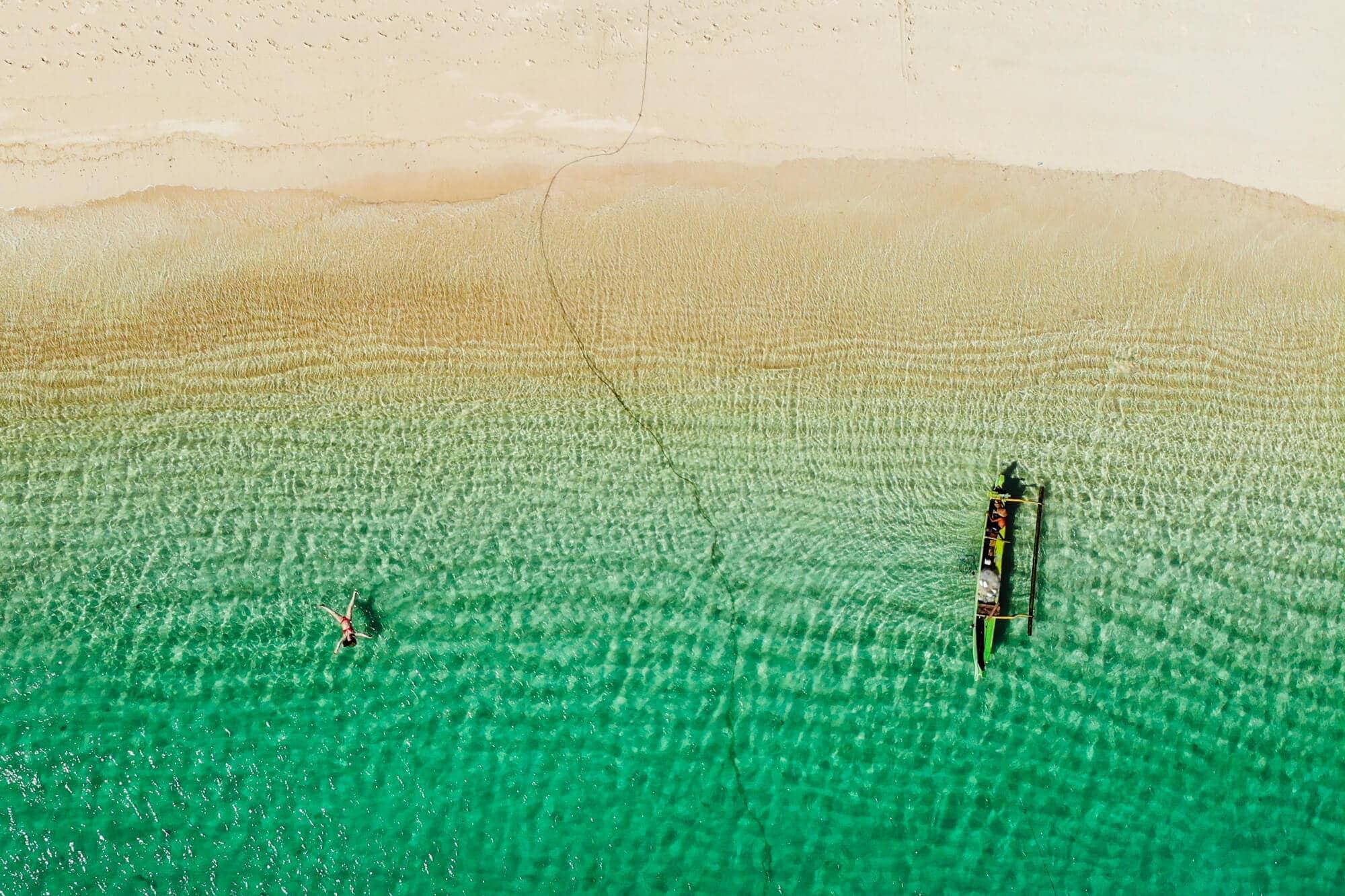 Follow along on our journey living in Kuta, Lombok for two months - Drone shot of Tanjung Aan Beach #lombok #kuta #indonesia #travelinspo #bucketlist