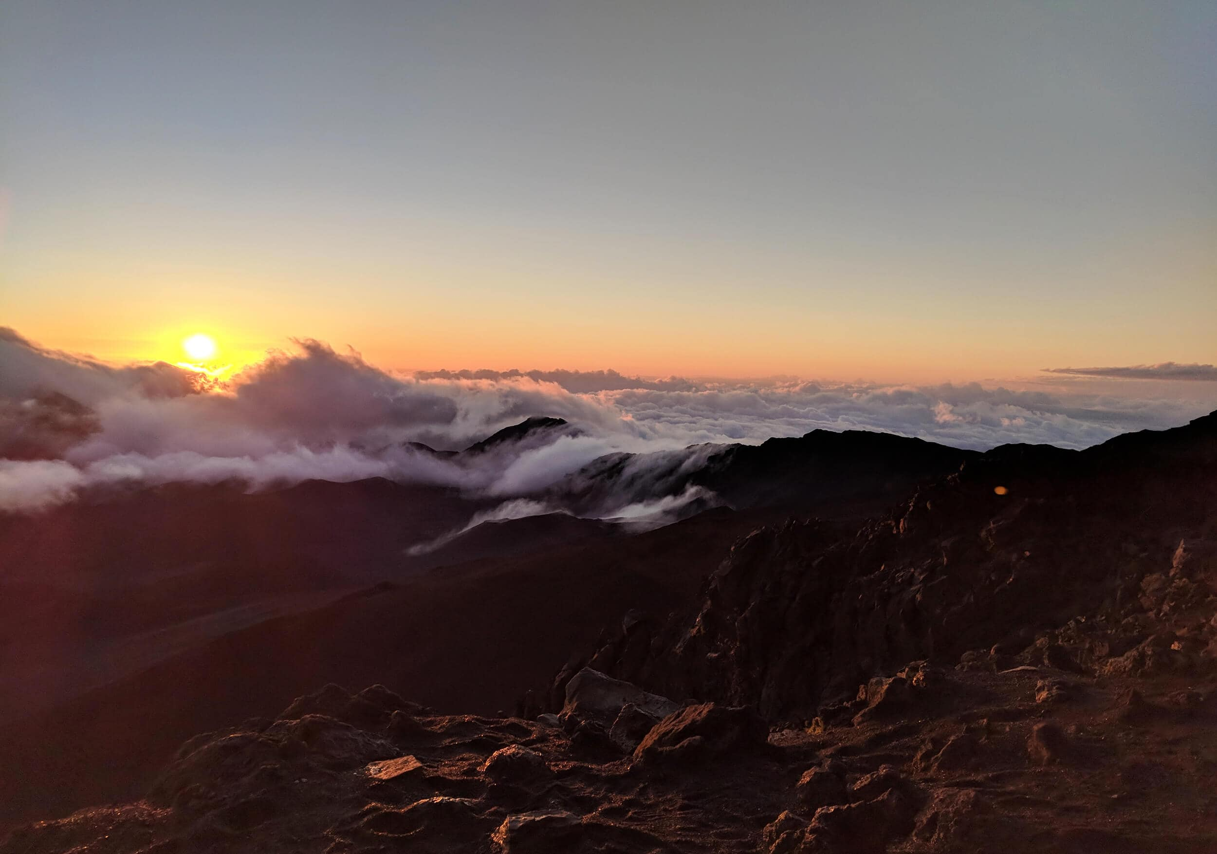 Travel bloggers reveal their most unforgettable travel experiences - Sunrise over Haleakala Volcano on Maui in Hawaii