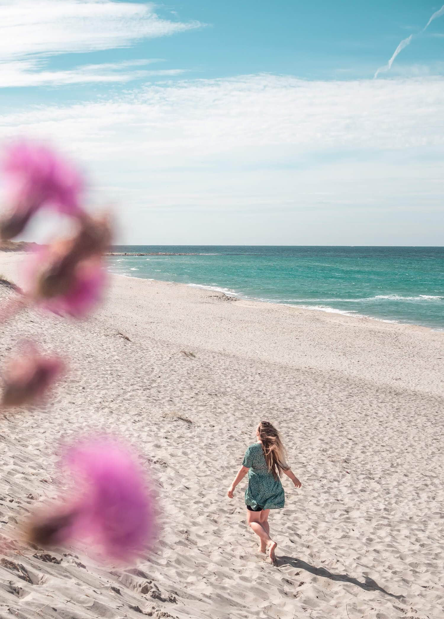 Girl running on the beautiful Orrestranda beach on the Jæren coast just south of Stavanger