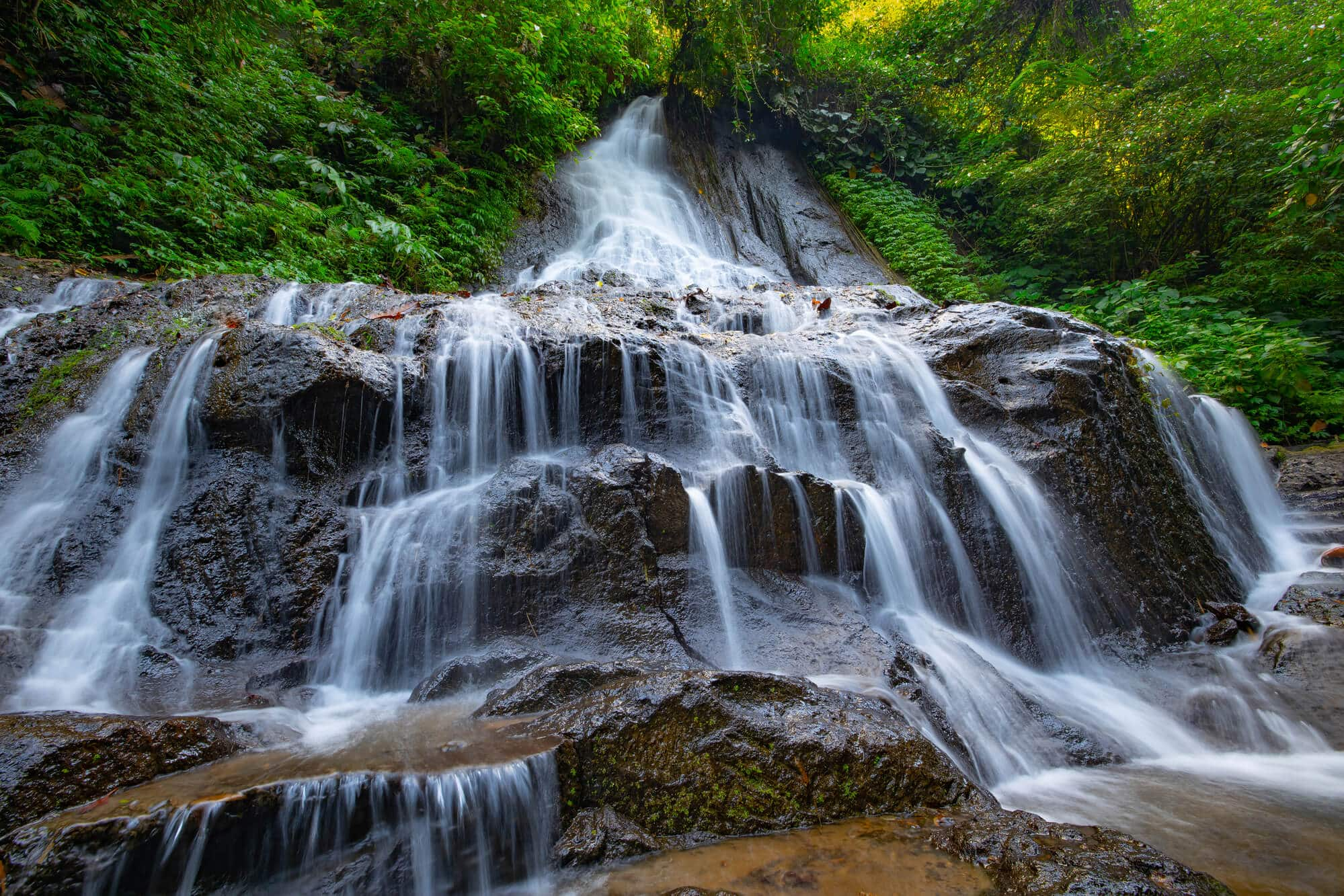 A guide to all the best waterfalls in Ubud Bali - Goa Giri Campuhan Waterfall, also known as GGC