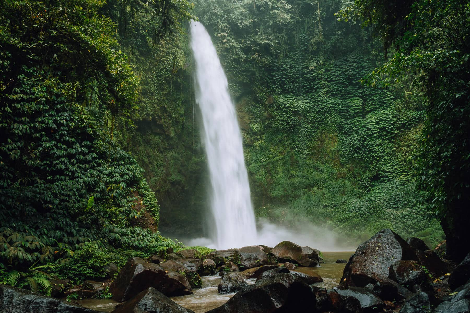 A guide to all the best waterfalls in Ubud Bali - View of the powerful Nungnung Waterfall