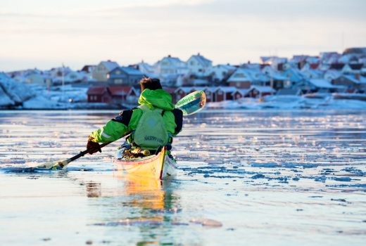 Man kayaking in icy winter sea at Smögen - Photo C