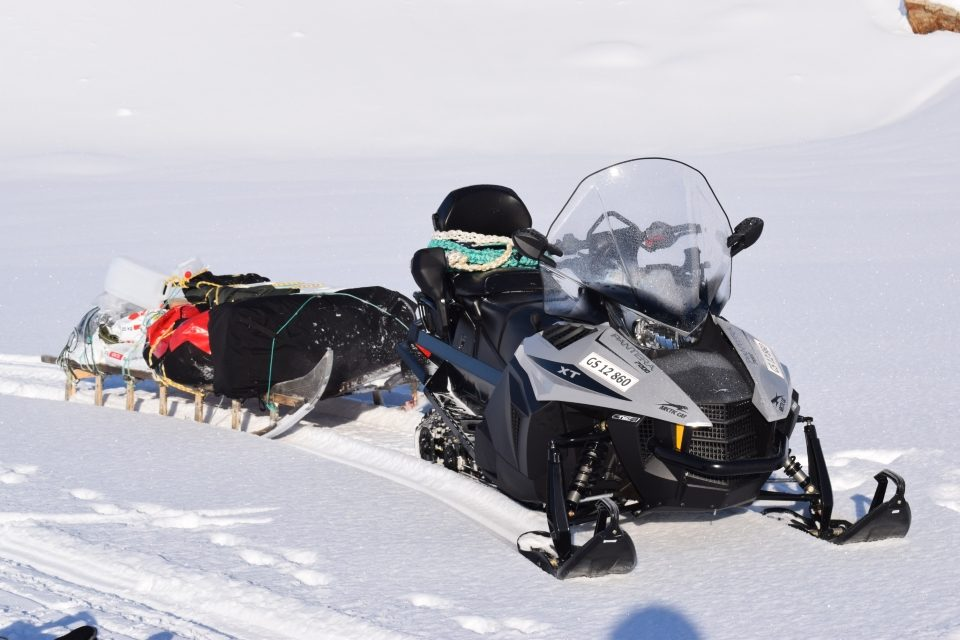 Snowmobile with sled