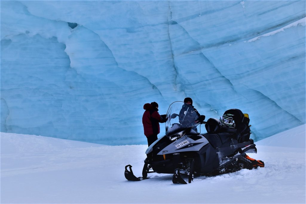 Snowmobile in front of glacier