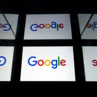 U.S. multinational technology and Internet-related services company Google's logo is displayed on a tablet in Paris. Google has agreed to pay €945 million ($1.0 billion) to settle a tax dispute in France under an agreement announced in court on Thursday.