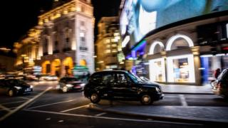 A London typical taxi is seen in Piccadilly Circus