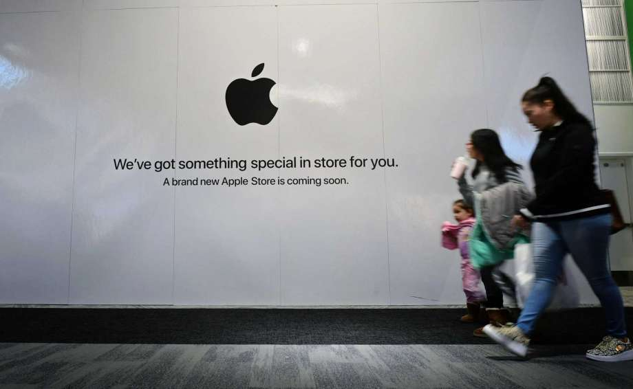 Shoppers walk past the sign heralding the arrival of the Apple store in the new SoNo Collection mall Saturday, December 14, 2019, in Norwalk, Conn. Photo: Erik Trautmann / Hearst Connecticut Media / Norwalk Hour
