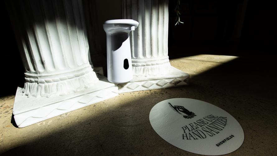hand sanitizer station next to pillars