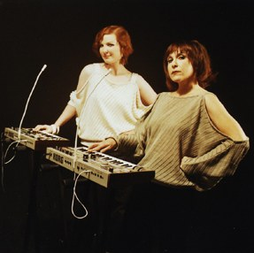 Two women with 20th century synthesisers