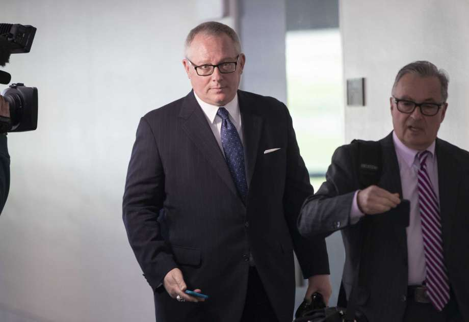 FILE - In this May 1, 2018, file photo, Former Donald Trump campaign official Michael Caputo, left, joined by his attorney Dennis C. Vacco, leaves after being interviewed by Senate Intelligence Committee staff investigating Russian meddling in the 2016 presidential election, on Capitol Hill in Washington. A House subcommittee examining President Donald Trump's response to the coronavirus pandemic is launching an investigation into reports that political appointees have meddled with routine government scientific data to better align with Trump's public statements. The Democrat-led subcommittee said Sept. 14, 2020 that it is requesting transcribed interviews with seven officials from the Centers for Disease Control and Prevention and the Department of Health and Human Services, including communications aide Michael Caputo. Photo: J. Scott Applewhite, AP / Copyright 2018 The Associated Press. All rights reserved.