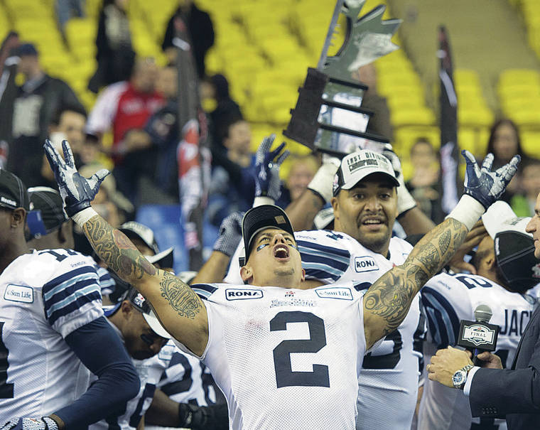 """ASSOCIATED PRESS / 2012                                 Chad Owens hosts the """"The CO2 RUN DWN,"""" the Honolulu Star-Advertiser's new Facebook Live sport talk show. Owens is shown here celebrating a Toronto Argonauts' victory on Nov. 18, 2012, in Montreal."""