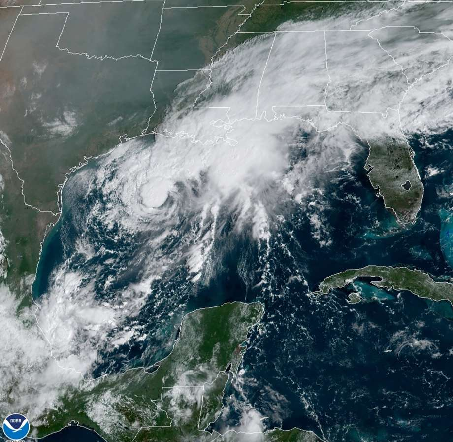 This GOES-16 GeoColor satellite image taken Saturday, Sept. 19, 2020, and provided by NOAA, shows Tropical Storm Beta, center,  in the Gulf of Mexico.  A hurricane watch is in effect Saturday for coastal Texas as Tropical Storm Beta gains strength.  A storm surge watch and a tropical storm watch are also in effect for the area during an exceptionally busy Atlantic hurricane season.  (NOAA via AP) Photo: AP / NOAA