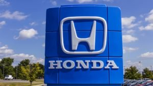 honda logo on a sign outside a honda dealership