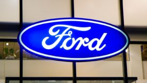 A Ford (F) sign hangs on a glass wall in Kiev, Ukraine.