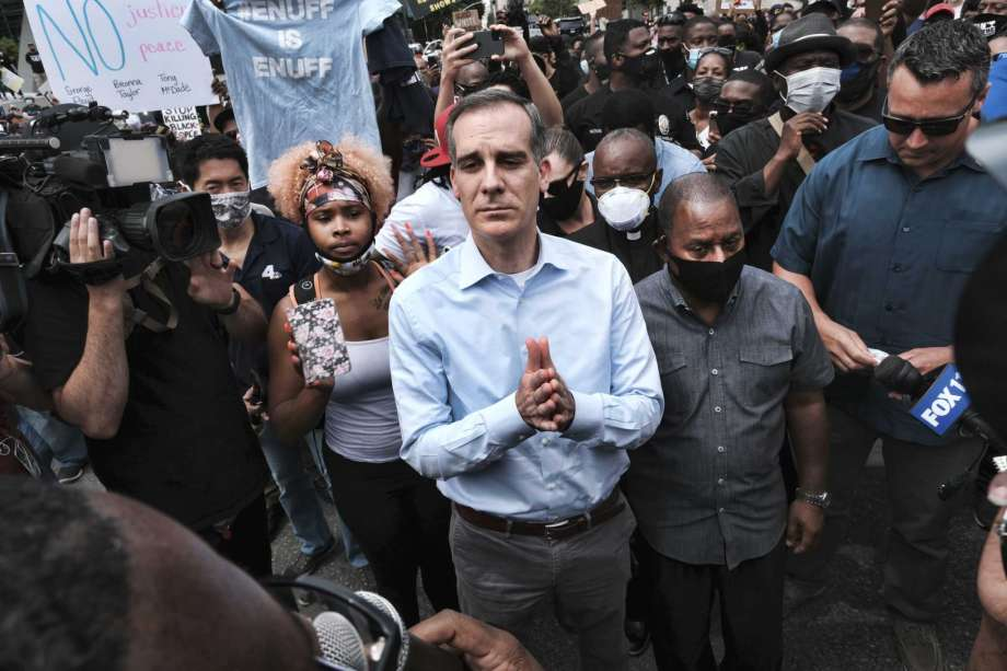 FILE - In this June 2, 2020, file photo, Los Angeles Mayor Eric Garcetti arrives to appeal to Black Lives Matter protesters in downtown Los Angeles. When Garcetti withdrew his support from District Attorney Jackie Lacey this week and endorsed her opponent, it was another blow to a campaign that has been reshaped after a summer of nationwide protests over police brutality. Photo: Richard Vogel, AP / Copyright 2020 The Associated Press. All rights reserved.