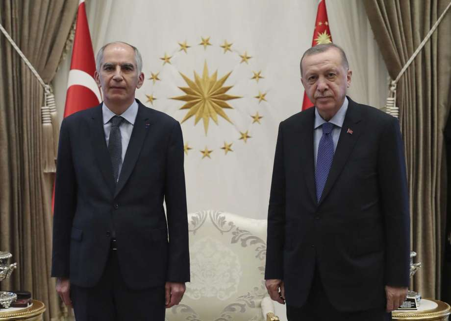 FILE - In this Aug. 19, 2020 file photo, Frence ambassador to Turkey Herve Magro, left, and Turkey's President Recep Tayyip Erdogan pose for photographs after the new ambassador presented his letter of credentials, in Ankara, Turkey. France recalled its ambassador to Turkey for consultations after Erdogan said Saturday, Oct. 24 French President Emmanuel Macron needed mental health treatment and made other comments that the French government described as unacceptably rude.(Turkish Presidency via AP, Pool) Photo: AP / Turkish Presidency
