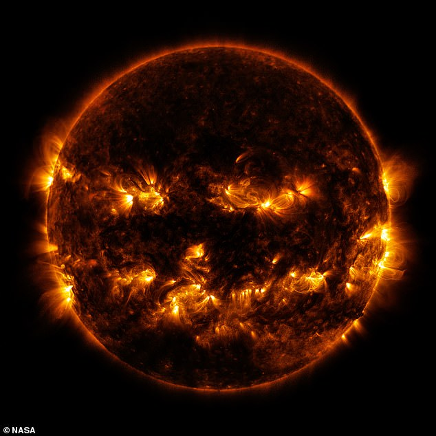 NASA posted another spooky photo that was out of this world - the sun glowing with a pumpkin face.The haunting illuminated 'face' smoldered on the sun's surface in 2014 when activity reached 'solar maximum', meaning more sun spots occurred