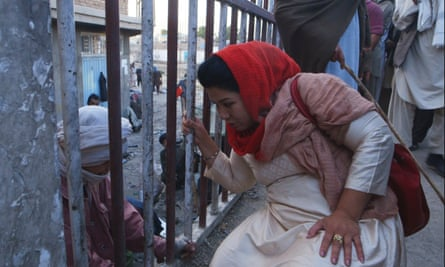 Laila Haidari speaking with a drug addict in Laila at the Bridge.