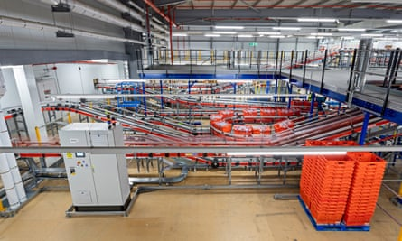 An automated bagging station at Ocado's Erith warehouse