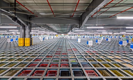 Robots picking products at Ocado's warehouse in Erith, Kent.