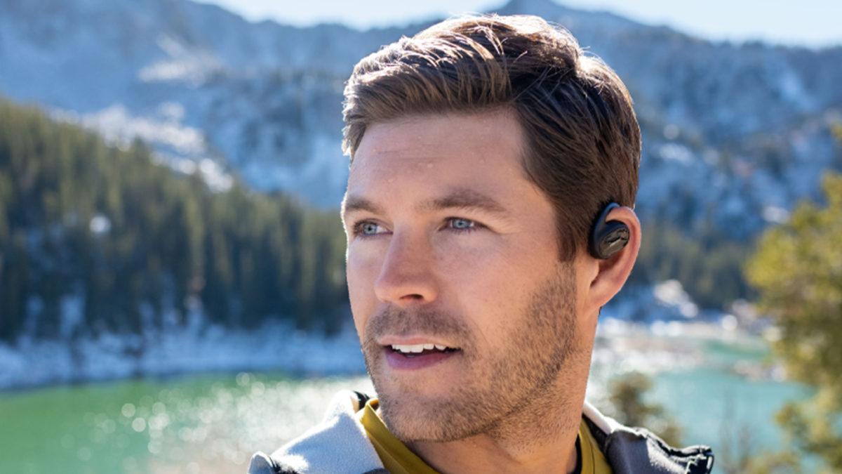 Bose sport open earbuds man wears