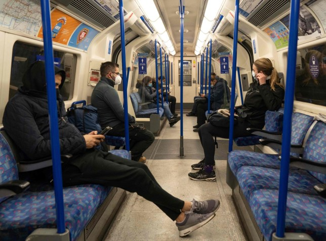 Commuters wear facemasks as they travel on the underground in London on November 5, 2020