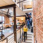 A team walks through a chic startup space.